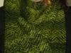 grüner Schal aus handgesponnener Wolle